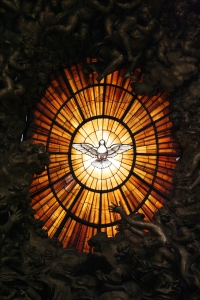 Stained glass window depicting the Holy Spirit. St. Peter's and Paul Basilica, Rome.